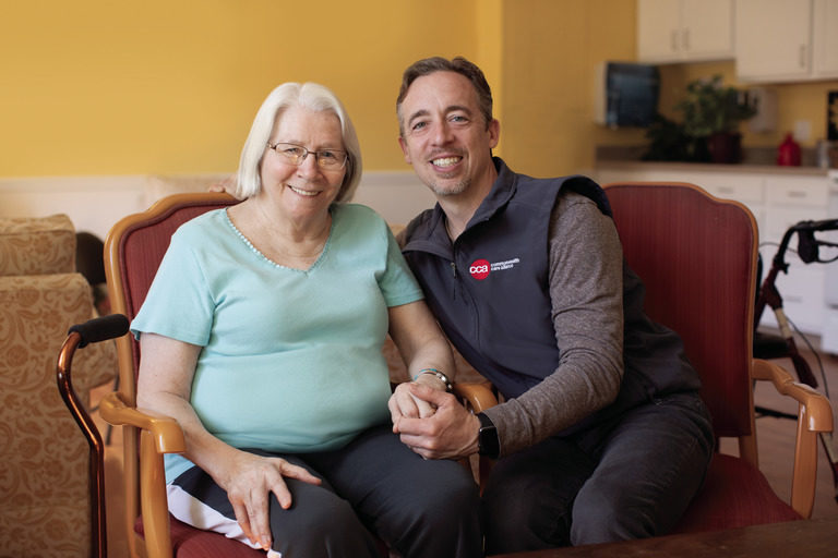 CCA Member and her Care Partner sitting in her living room