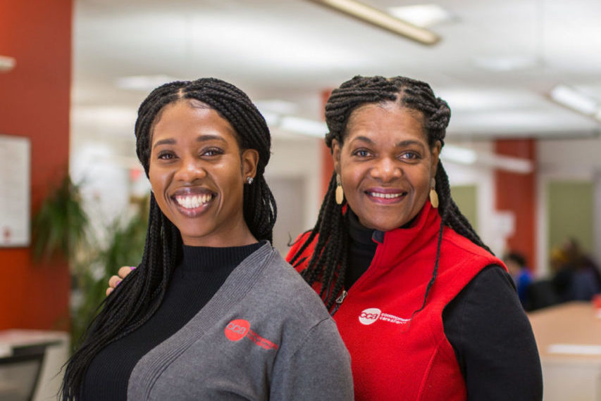 Two welcoming Commonwealth Care Alliance female medical professionals smiling